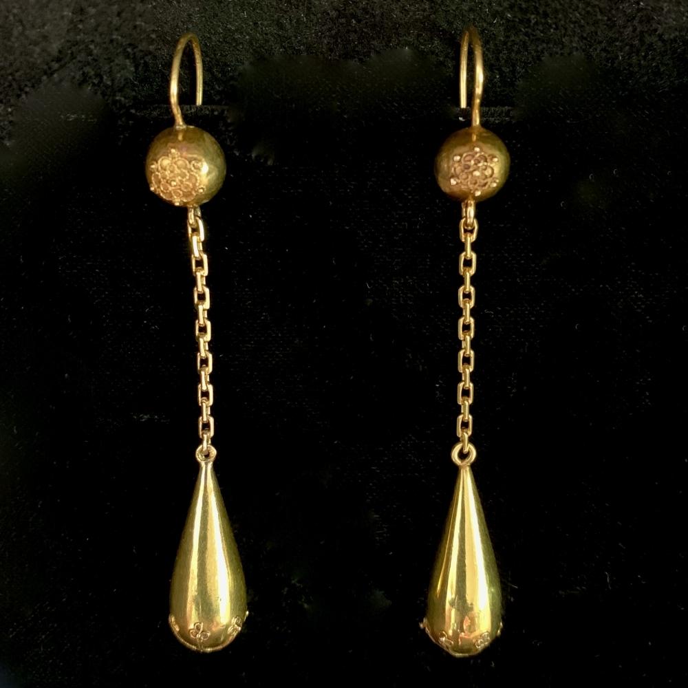 Lange gouden oorhangers