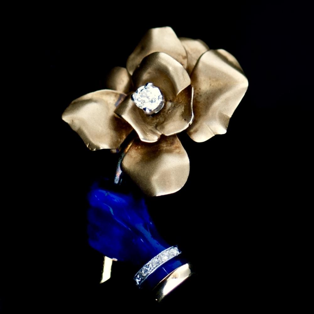 Cartier brooch of gold, blue enamel and diamond