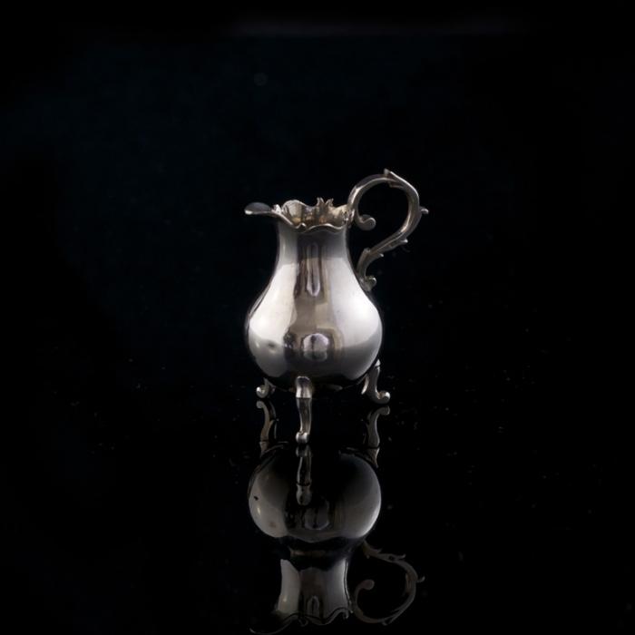 antiek miniatuur zilveren melkkan