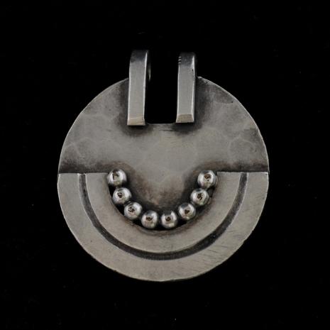 Round pendant by Jean Deprés
