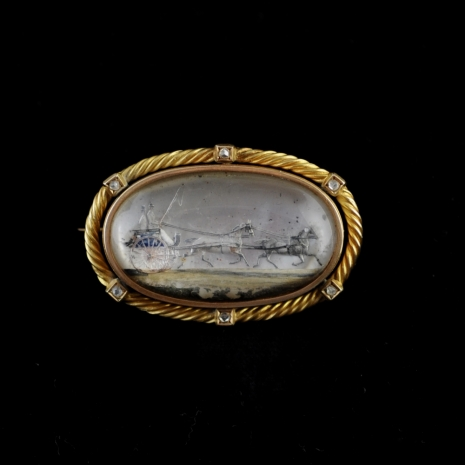 Rock crystal brooch with two wheeled cart (Essex crystal)