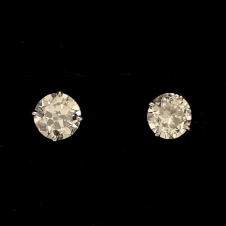 Earrings with large mine cut diamonds
