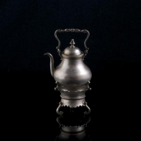 miniature silver kettle on brazier